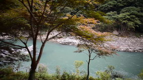 View of Hozugawa River from Sagano Scenic Railway stock footage