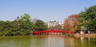 View of the The Huc bridge with Hoan Kiem lake in Hanoi, Vietnam Stock Photo