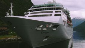 View of huge cruise liner on river at mountains covered by green woods. Nature. Landscape. Ship stock footage
