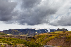 View on a huge mountain with glacier in Iceland with dramatic sky Royalty Free Stock Images