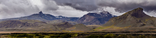 View on a huge mountain and small house in Iceland with dramatic sky Royalty Free Stock Image