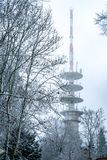 View of Huge radio tower. During winter on top of the hill in snow Royalty Free Stock Images