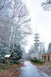 View of Huge radio tower. During winter on top of the hill in snow Stock Image