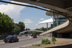 View of the humpbacked pedestrian bridge near the house of justice in Tbilisi, Georgia. New building of Ministry of Justice and Civil Registry Agency in Tbilisi stock image