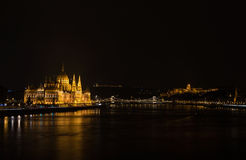 View of Hungarian Parliament Building, Royal Palace and Danube  river from Margit bridge at night. View of Hungarian Parliament Building, Royal Palace and Stock Image