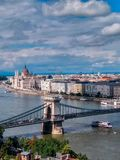 View of Hungarian parliament at Danube river in Budapest city, Hungary. stock photos
