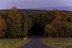 Blue Hill at Sunset / Blue Hour - Catskill Mountains, New York. A view of Hunter Road from Blue Hill looking east towards Sugarloaf Mountain and Thunder Hill at stock photography