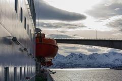 View from hurtigruten ship nordnorge to a fjord bridge royalty free stock photography