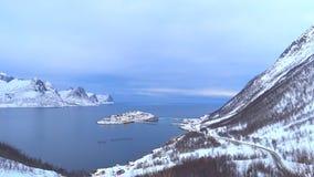 View on Husøy, Senja fishing village in the Øyfjorden in Troms County in Nort. Hern Norway during winter stock video footage