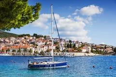 Sailing boat in a beautiful bay of the Hvar island, Dalmatia, Croatia stock images