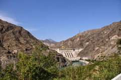 View of the hydroelectric power plant in Kyrgyzstan. On the Naryn river, hot summer, turquoise river. trip to Kyrgyzstan Royalty Free Stock Images