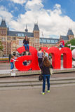 View at the I Amsterdam sign with tourists in front of the Rijks Royalty Free Stock Photos