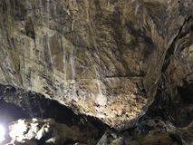 Iluminated walls in Ialominta cave. View from Ialomita Cave, located in the Valley lalomitei, Gorge Cave, at an altitude of 1660 m, Romania stock photography