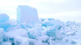 View of ice blocks cover with snow in frozen Lake Baikal stock video footage