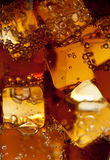 View of the ice cubes in cola background Royalty Free Stock Photography