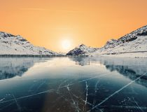 Climate change concept. View of ice Lake and Sunset: climate change concept royalty free stock photo