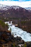 View on ice mountain, forest and river, Norway Stock Photo