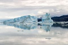 View of an iceberg reflected in the water in Upsala, Argentina stock images