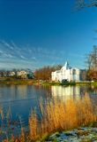 View of iced lake with classical building Royalty Free Stock Images