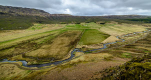 A view of an Icelandic valley from a mountain above Stock Images