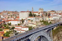 View of the iconic Dom Luis I bridge that crosses the Douro River. And the historical Ribeira and Se District in the city of Porto, Portugal. Unesco World Royalty Free Stock Photography
