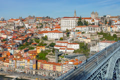 View of the iconic Dom Luis I bridge that crosses the Douro River. And the historical Ribeira and Se District in the city of Porto, Portugal. Unesco World Royalty Free Stock Photo