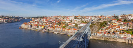 View of the iconic Dom Luis I bridge crossing the Douro River. And the historical Ribeira and Se District in the city of Porto, Portugal. Unesco World Heritage Stock Photo