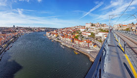 View of the iconic Dom Luis I bridge crossing the Douro River. And the historical Ribeira and Se District in the city of Porto, Portugal. Unesco World Heritage Stock Image