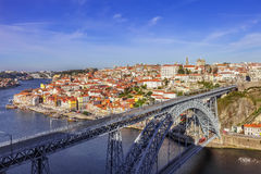 View of the iconic Dom Luis I bridge crossing the Douro River. And the historical Ribeira and Se District in the city of Porto, Portugal. Unesco World Heritage Stock Photography