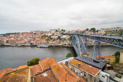 Porto, Portugal - July 2017. View of the iconic Dom Luis I bridge crossing the Douro River, and the historical Ribeira and Se Dist. View of the iconic Dom Luis I Stock Photo