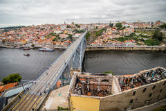 Porto, Portugal - July 2017. View of the iconic Dom Luis I bridge crossing the Douro River, and the historical Ribeira and Se Dist. View of the iconic Dom Luis I Royalty Free Stock Photos