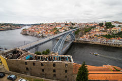 Porto, Portugal - July 2017. View of the iconic Dom Luis I bridge crossing the Douro River, and the historical Ribeira and Se Dist. View of the iconic Dom Luis I Royalty Free Stock Photo