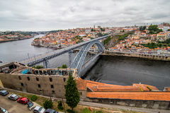 Porto, Portugal - July 2017. View of the iconic Dom Luis I bridge crossing the Douro River, and the historical Ribeira and Se Dist. View of the iconic Dom Luis I Stock Image