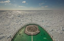 A view of the icy field of the Kara Sea from the nose of a Russian military icebreaker. Arctic cruises stock image