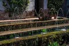 View if the Generalife courtyard Patio de la Acequia. Fountain and garden Royalty Free Stock Photo