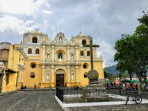 A view of the Iglesia de La Merced, Antigua Guatemala. The yellow baroque church is one of the most iconic churches in town stock photography