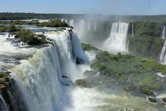 View from Iguassu Falls in a sunny day of summer. View from the Brazilian side of the Iguassu Falls in the foreground and the Argentinian side on the backgorund Royalty Free Stock Photo