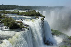 View from Iguassu Falls in a sunny day of summer. View from the Brazilian side of the Iguassu Falls in the foreground and the Argentinian side on the backgorund Royalty Free Stock Image