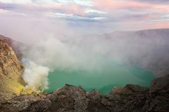 View from Ijen Crater, Sulfur fume at Kawah Ijen, Vocalno in Indenesia. Adventure asia beautiful blue east java foggy gas hard indonesia lake landmark landscape stock photos