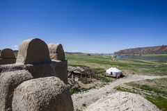 View at the Ile river and Tamgaly Tas mountains, an a yurt from a movie castle. Kazakhstan - Centra Stock Photos