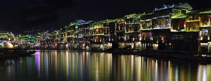 View of illuminated riverside houses in Fenghuang Stock Photo