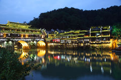 View of illuminated riverside houses in Fenghuang Stock Image