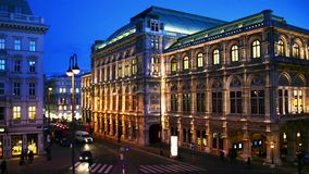 View of illuminated State Opera in Vienna, Austria during the night. Vienna, Austria. View of illuminated State Opera in Vienna, Austria during the night. Blue stock video footage