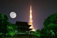 View of illuminated Tokyo Tower & Japanese Shrine. At night on full moon day royalty free stock photography