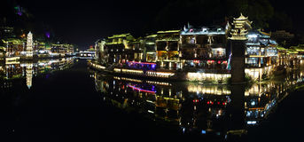 View of illuminated Wanming Pagoda in Fenghuang, Stock Photo