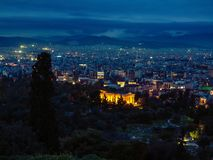 View of illumination Athens city with Lycabettus hill in the background. Plaka neighborhood. Night scene. View of Athens city with Lycabettus hill in the Royalty Free Stock Photography