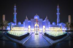 Sheikh Zayed Grand Mosque in Abu-Dhabi, UAE. View of illumination in garden of Sheikh Zayed Grand Mosque at night, United Arab Emirates royalty free stock images