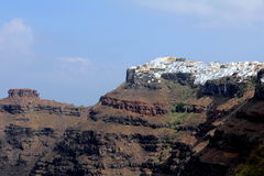 View Of Imerovigli In The Morning - Santorini Island. Panoramic view of Imerovigli in Santorini in the morning with the rock on the left Stock Photos