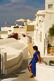 View of Imerovigli with a woman with a blue dress stock photography