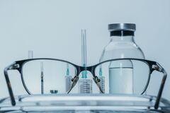 Free View In Glasses. Medicine, Injection, Vaccine And Disposable Syringe Isolated, Drug Concept. Sterile Vial Medical. Macro Stock Images - 171076724